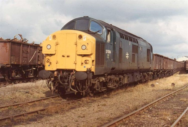 37084 stands at Consett Low Yard with a trainload of scrap from the closed steel works during 1981