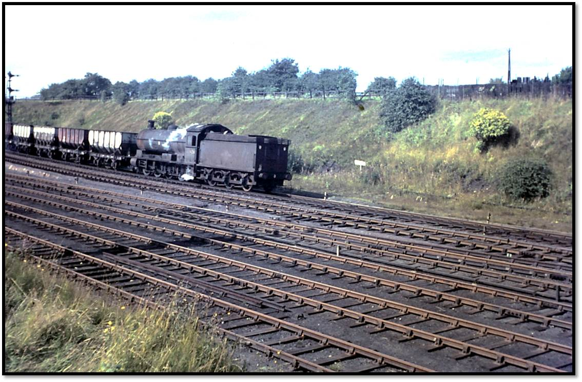Q6 63436 drifts down the incline at South Pelaw Junction tender first with a rake of coal wagons on Thursday September 8, 1966