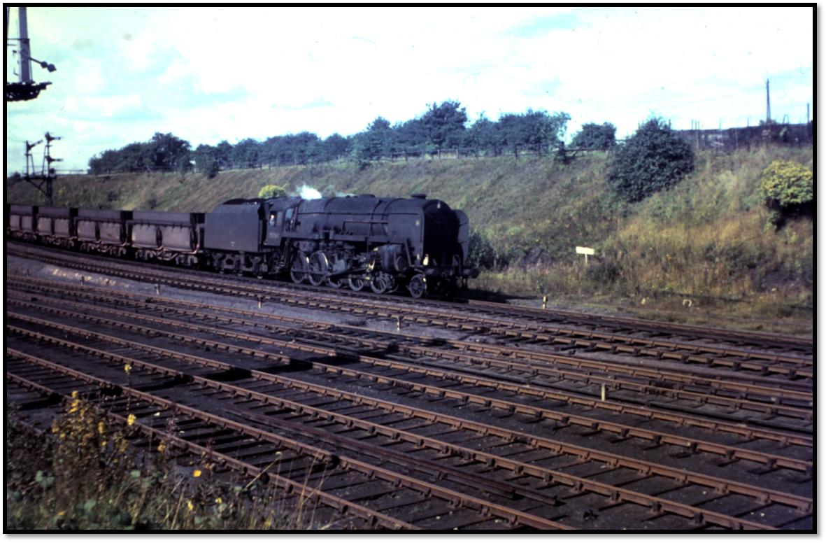 Tyne Dock 9F 92063 has the easy task of drifting down the bank with the iron ore empties on 8 September 1966.