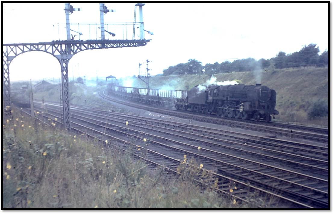 Tyne Dock 9F 92065 heads a rake of coal wagons on 8 September 1966. 92065 was the only Tyne Dock 9F to escape, being reallocated to Wakefield