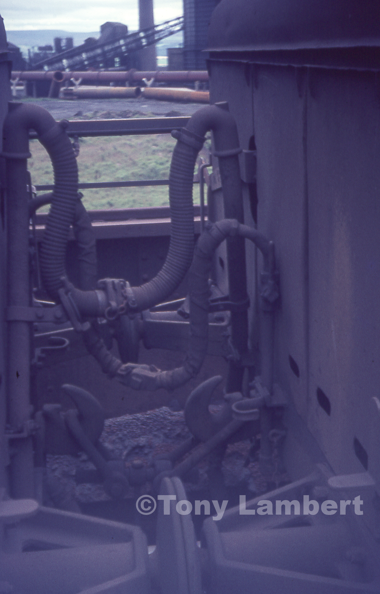 Detail of air and vacuum pipes on iron ore wagons. Photo copyright Tony Lambert