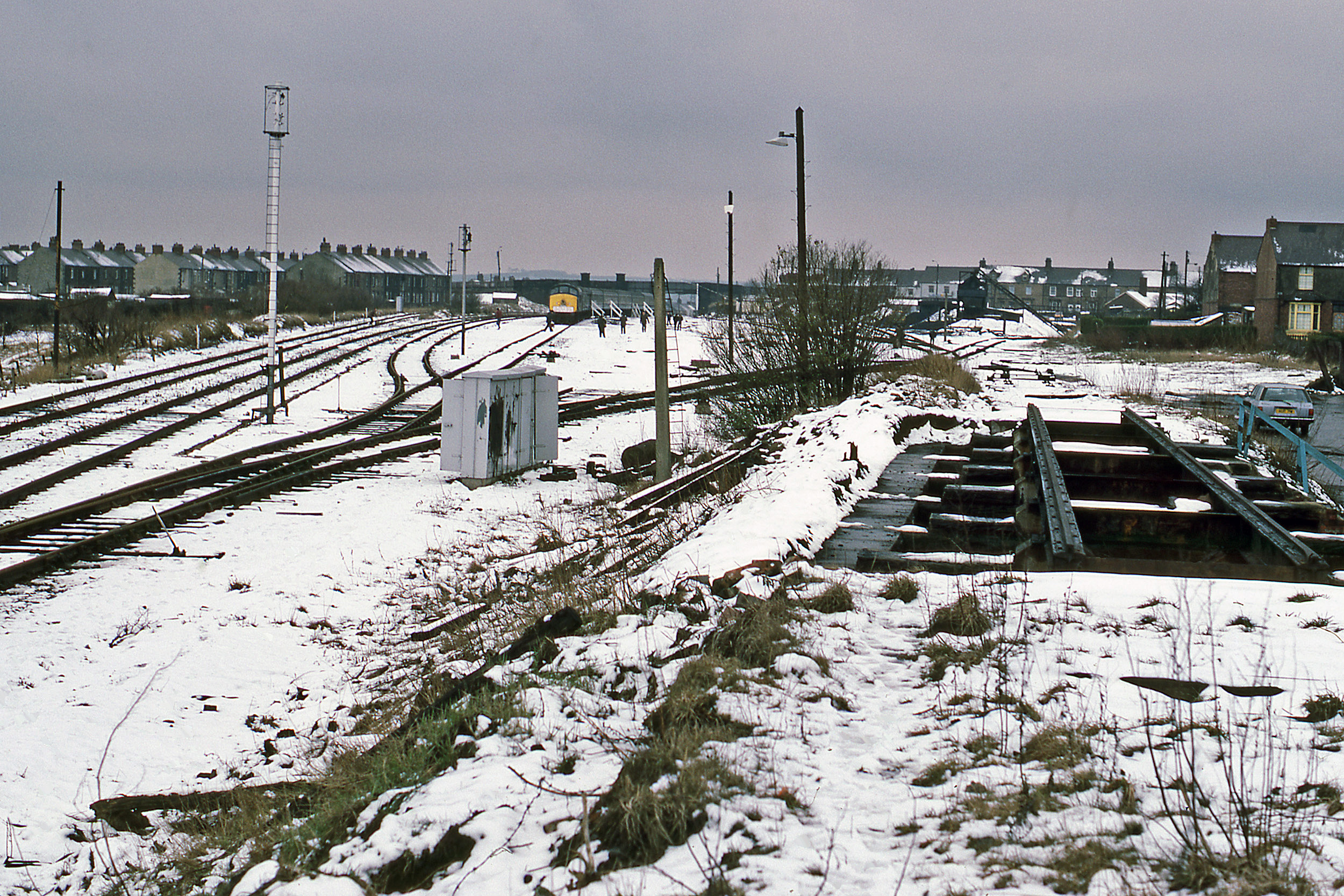 An overall view of the site of Consett station with 46026 in the background. Not the remains of the coal drops in the foreground and the coal yard (the last business served by the line) in the left background. Photo copyright Stephen McGahon