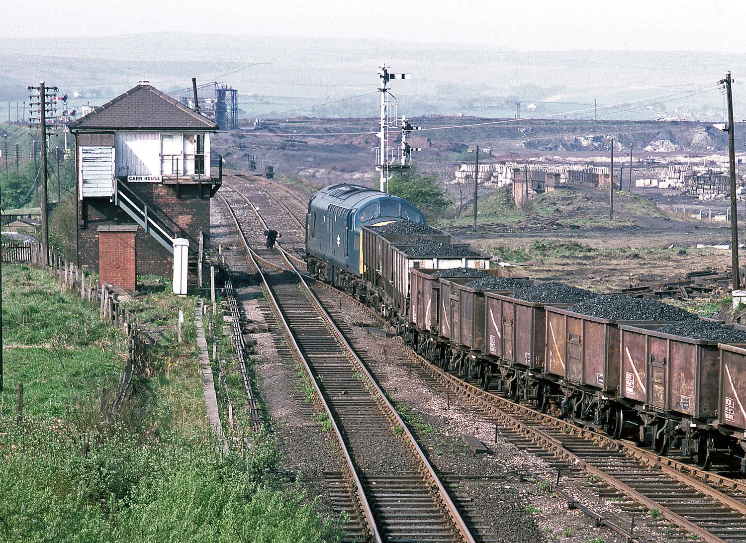 37094 again passes Carr House signal box on 10 May 1982 with a coal train made up of 21 and 16 tonne wagons. Photo copyright Stephen McGahon