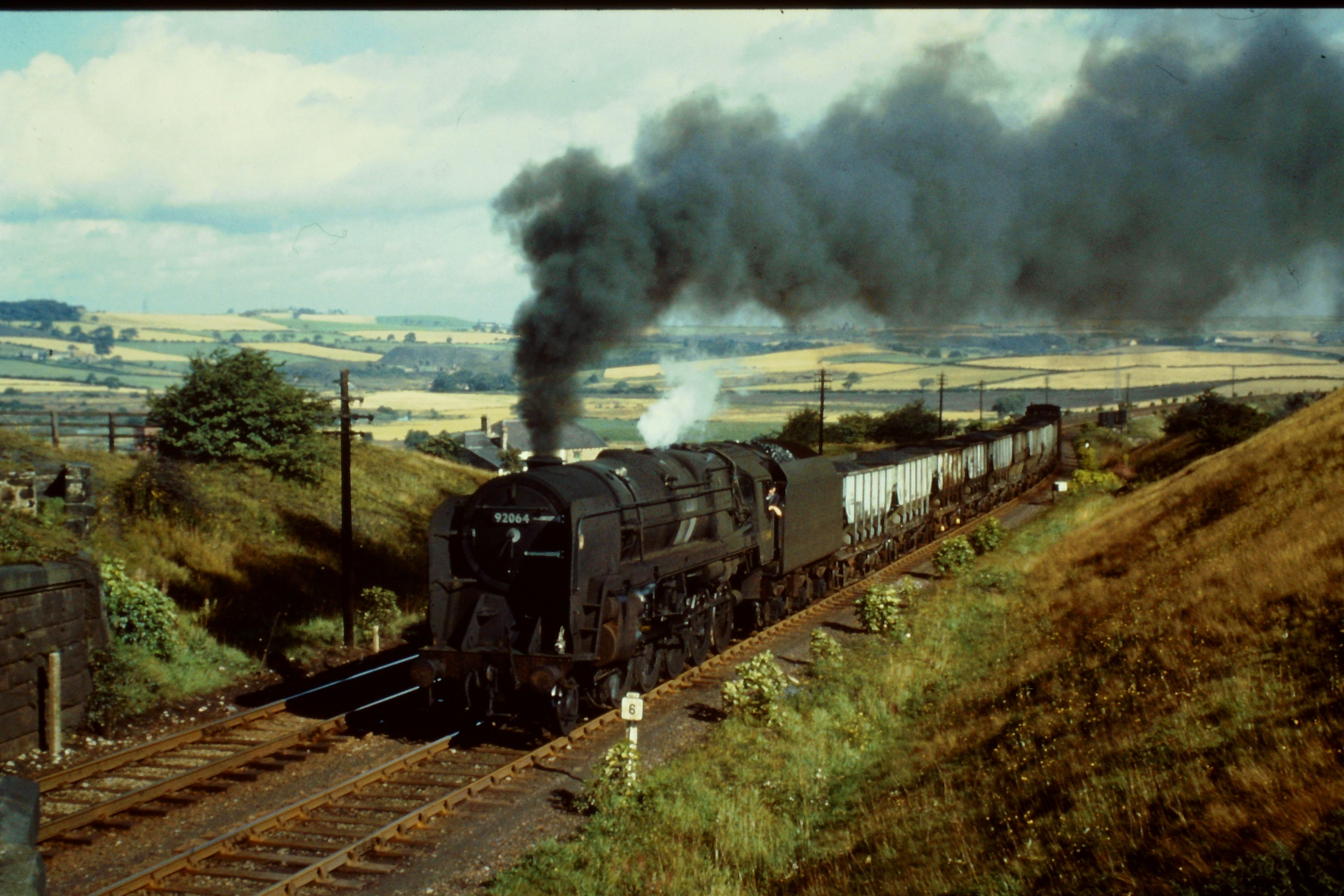 9F 92064 heads a train of 21T hoppers between Pelton and Beamish. Photo Author's Collection