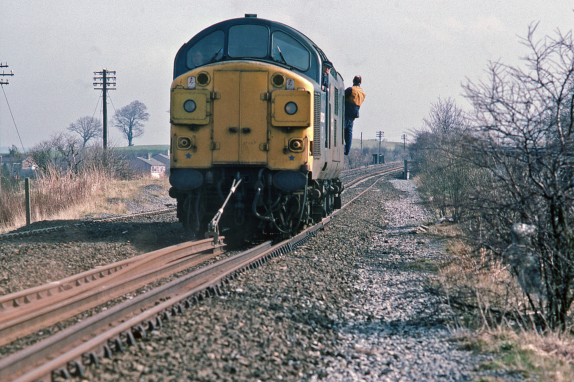 37023 drags lengths of rail at the site of West Stanley station on 27 March 1984