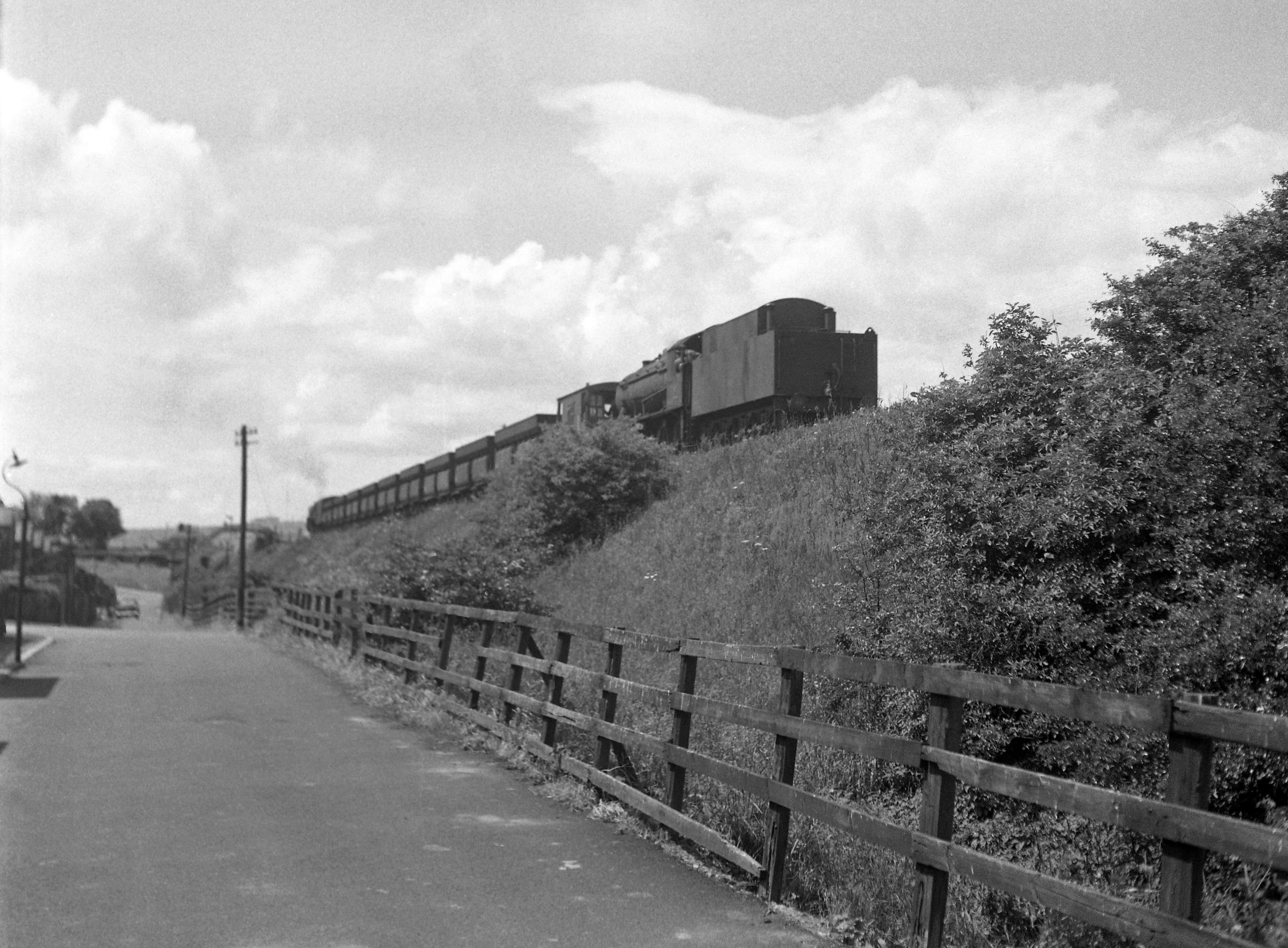 The rear end of the train in the photo above showing the WD locomotive acting as the banker. Photo copyright Rail-Online