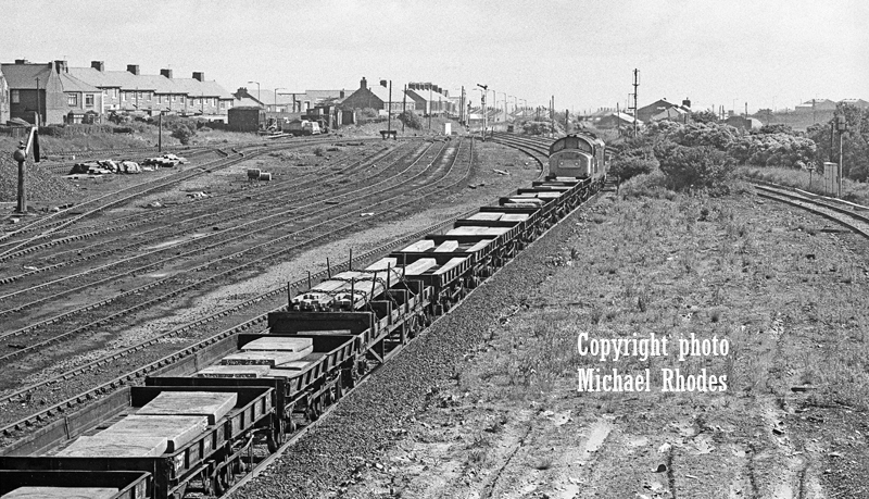 The site of Consett station in June 1980 just weeks before Consett Steelworks closed. 37166 heads a Consett to Tyne yard freight. Photo copyright Michael Rhodes