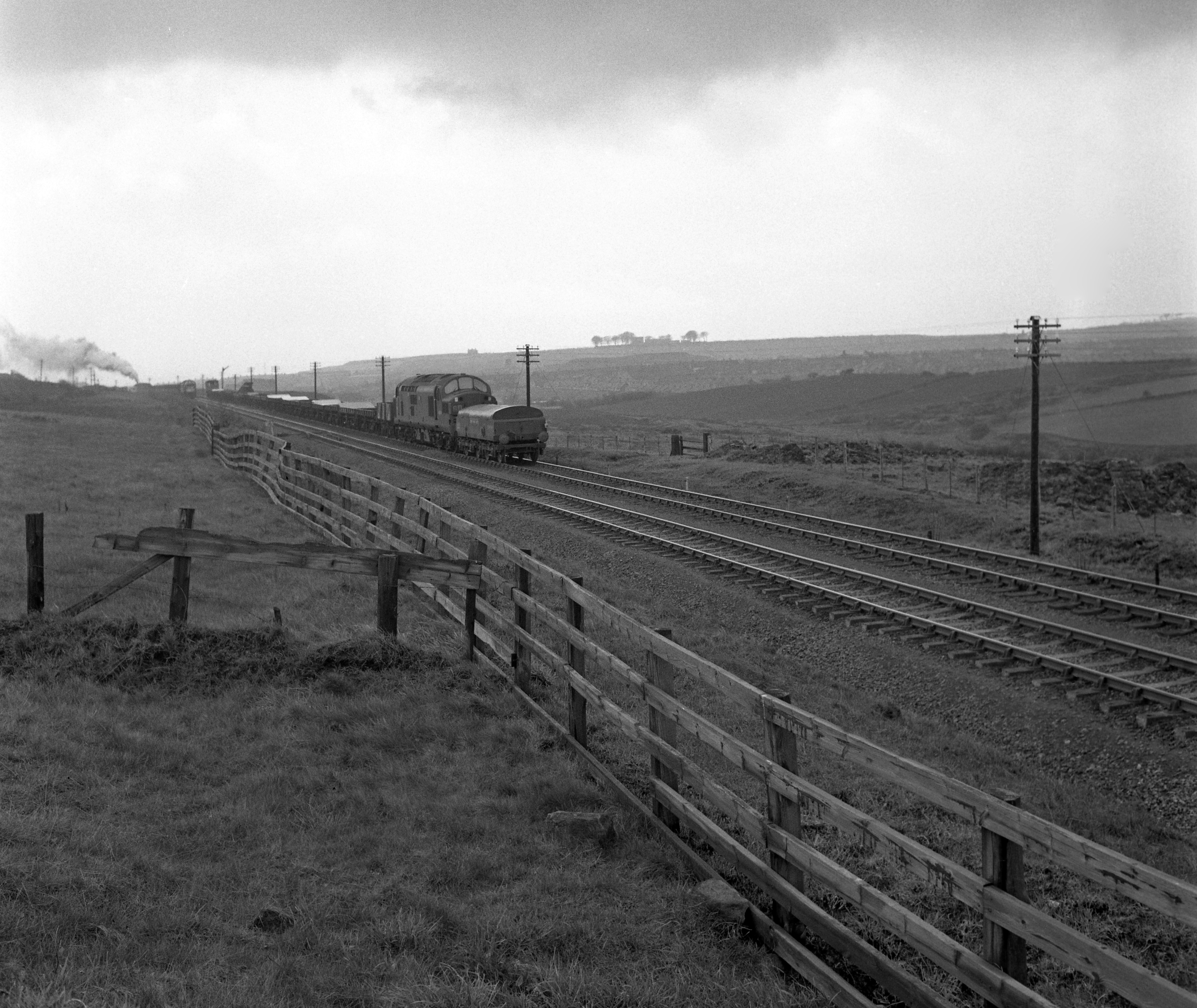 D6789 at Annfield Plain heading towards Stanley on 27 April 1965. Note the iron ore train heading towards Consett. Photo copyright Rail Online.