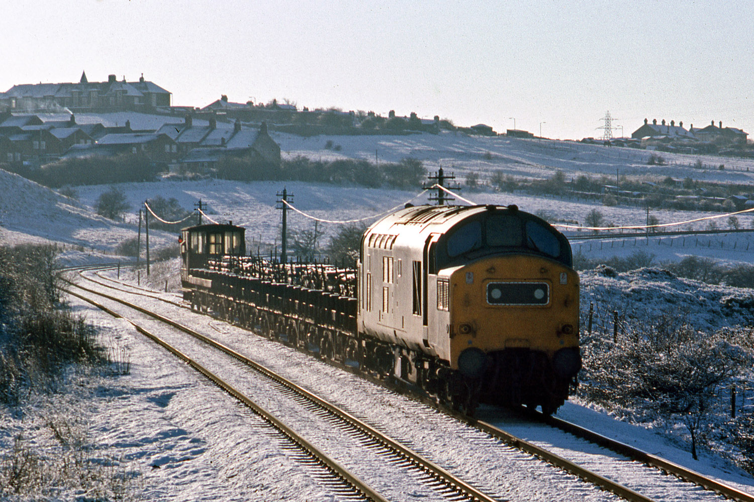 An unknown Class 37 passes Stanley with steel from Consett in January 1978. Photo copyright Stephen McGahon