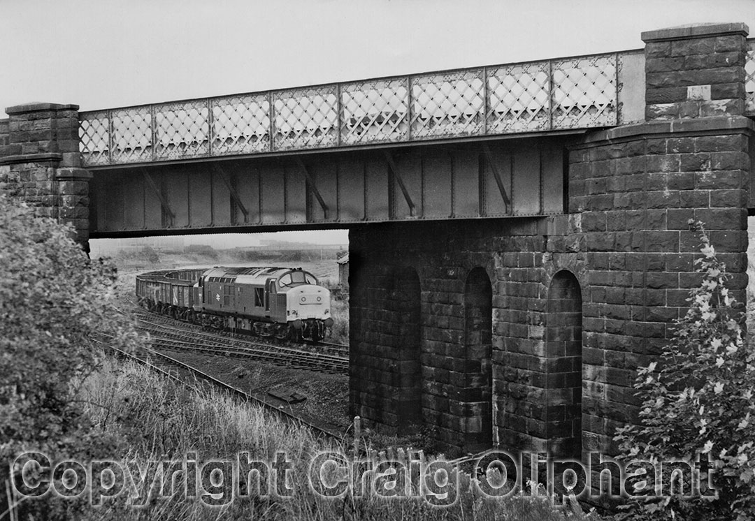 37198 shunts a scrap train in Consett Low Yard seen through the former Durham Branch span of the line linking with the High Yard in September 1983. Photo copyright Craig Oliphant