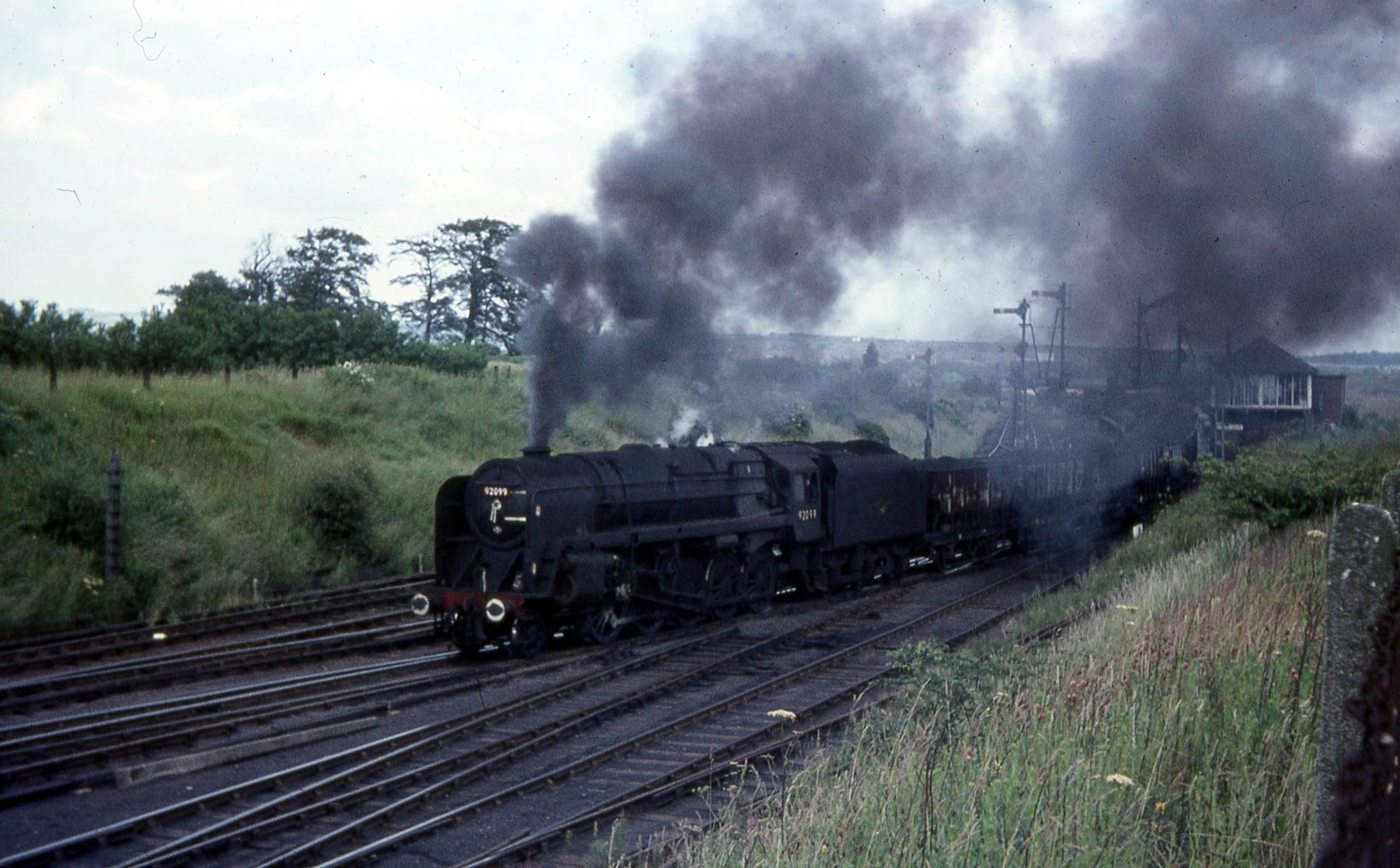9F 92099 at South Pelaw Junction with a train of 21T coal hoppers for Consett. Photo copyright Roy Lambeth