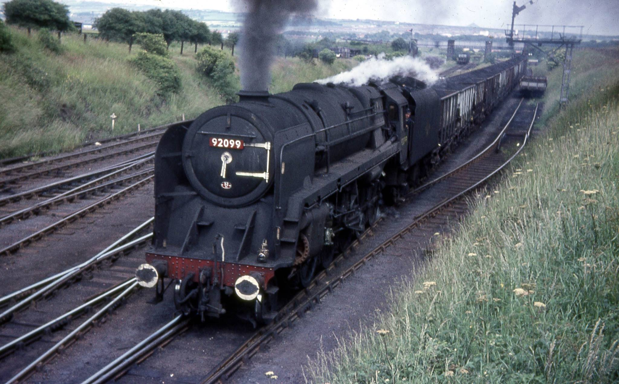 9F 92099 arrives at South Pelaw Junction with a train of 21T coal hoppers for Consett. Photo copyright Roy Lambeth