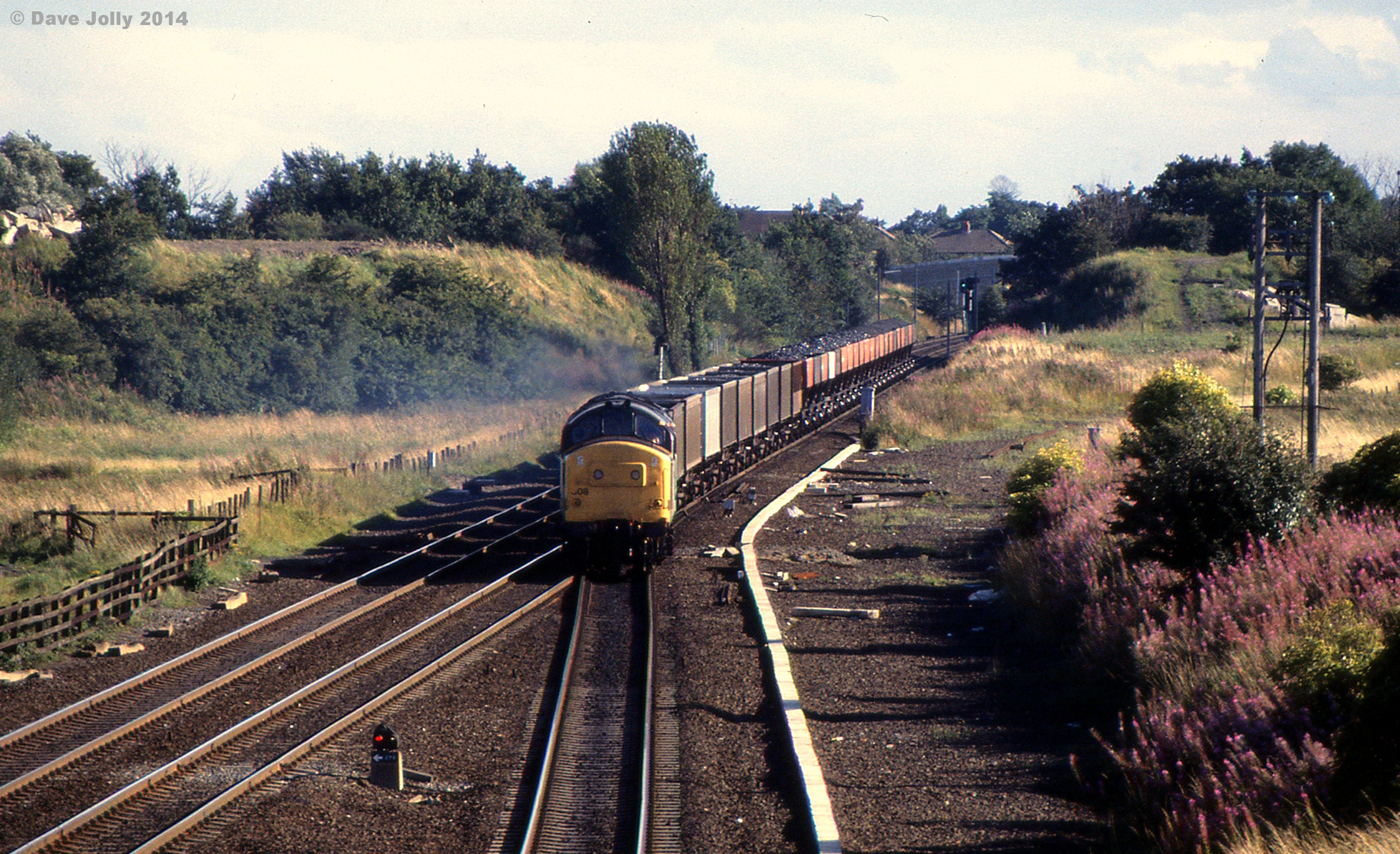 37308 crossing Ouston Junction with 6S67 1452 Speedlink Coal from Healey Mills to Gartcosh 19/08/1988. Photo copyright Dave Jolly