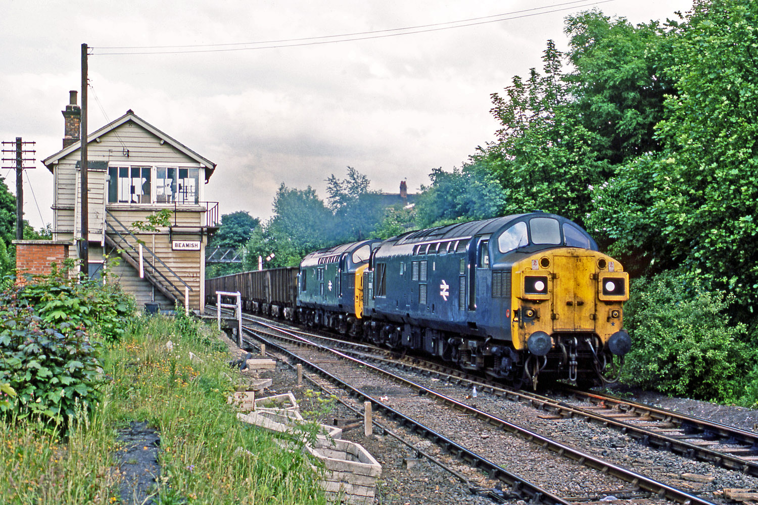 37079 and 37016 head through Beamish with an iron ore train on 20 June 1978. Photo copyright Stephen McGahon